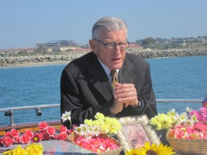 Pastor David performing burial at sea in San Diego