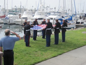 Servicemen carrying the American Flag